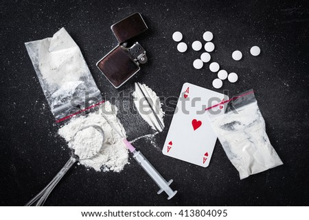 Hard drugs on dark table - stock photo