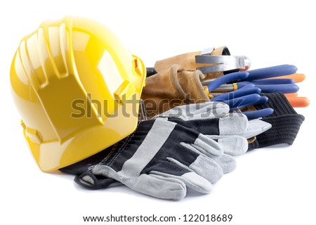 Hard hat and gloves with construction tool belt and carpentry tools inside - stock photo