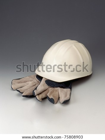 Hard Hat And Leather Gloves - stock photo