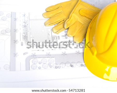 Hard Hat And Leather Gloves on white - stock photo