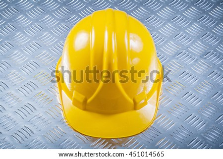 Hard hat on fluted metal background construction concept. - stock photo