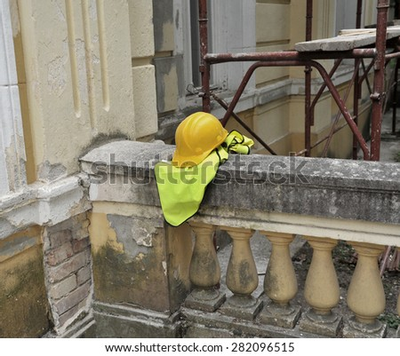 Hard hat on the construction - stock photo