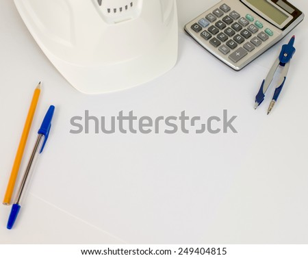 Hard hat, pen, pencil, calculator and compasses on white surface - stock photo