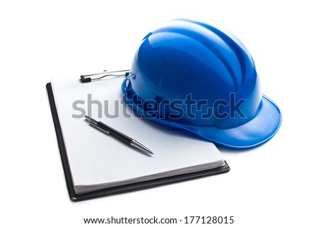 hard hat with clipboard on white background - stock photo