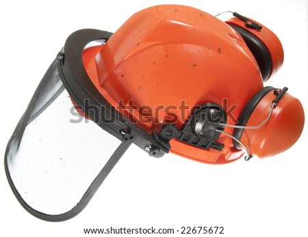 Hard hat with ear defenders and face mask  for protect while using a chain saw
