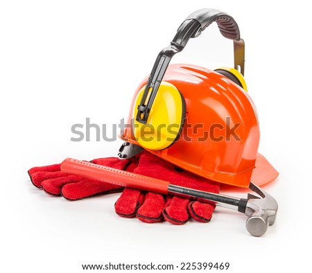 Hard hat with tools. Isolated on a white background. - stock photo