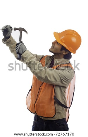 hard hat worker using a hammer - stock photo