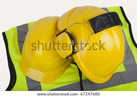 Hard hats and hi-vis jacket. Selection of PPE commonly in use - stock photo