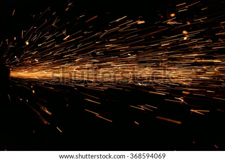 Hard job  with  sparks from abrasive grinder circle - stock photo