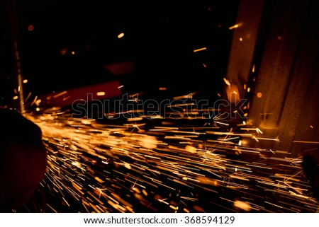 Hard job  with  sparks from abrasive grinder circle