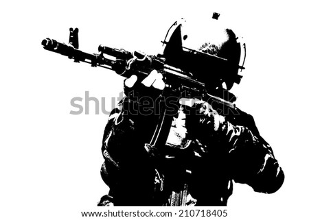 Hard light image of spec ops soldier in face mask with his rifle - stock photo