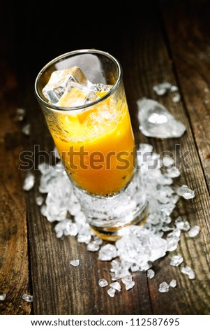Hard Liquor Orange Juice Shooter on a countertop with crushed ice and alcohol for drink concepts look at my portofolio - stock photo