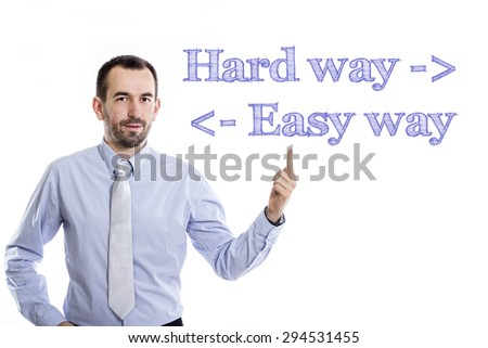 Hard way, easy way  Young businessman with small beard pointing up in blue shirt