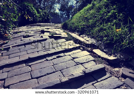 Hard way uphill along the brick path. hipster style. vintage view. - stock photo
