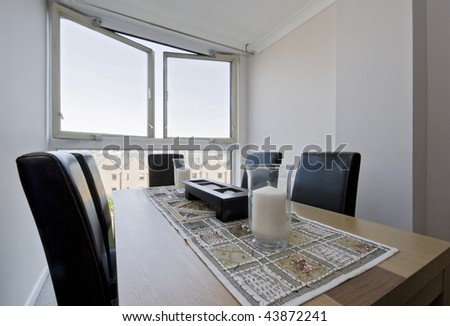 hard wood dining table with designer leather chairs - stock photo