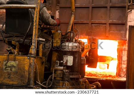 Hard work in a factory - stock photo