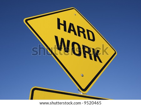 Hard Work road sign with deep blue sky background. Contains clipping path.