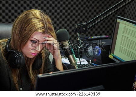 Hard Work Woman Serious And Moody While Working As Training DJ Radio Live Show In Studio