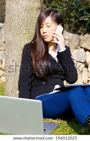Hard working asian woman with technology - stock photo