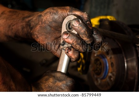 Hard working man with hands full of oil - stock photo