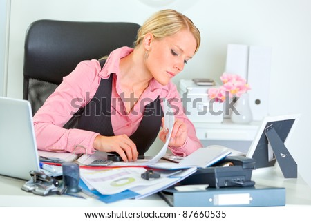Hard working on documents business woman - stock photo