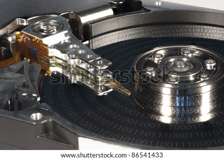 Harddrive with binary code on surface - stock photo