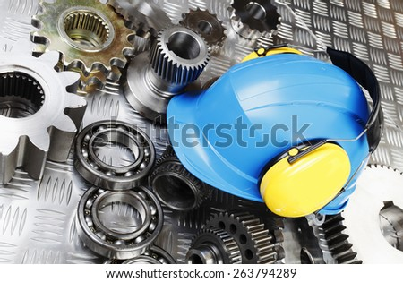 hardhat and ear-muffs, engineering parts, safety and protection gear concept - stock photo