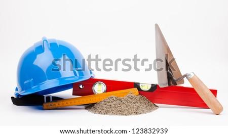 hardhat and mason tools isolated on white - stock photo