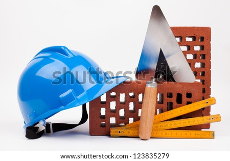 hardhat bricks and mason trowel - stock photo