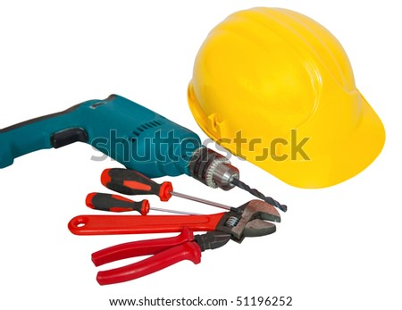 hardhat, drill, screwdriver, turnscrew, wirecutter, spanner and wrench isolated on white