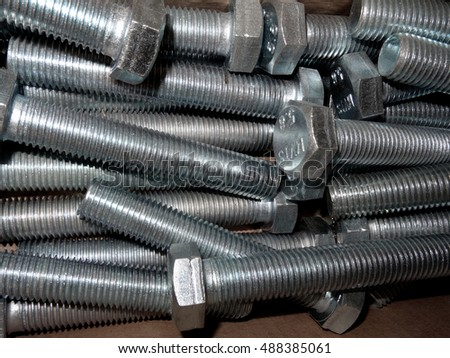 Hardware store. Hex screw bolts closeup texture background
