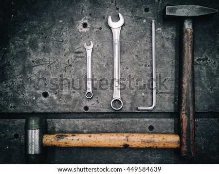 Hardware tools set on dark background, Light and shadow of craftsman tool. Vintage tone. Top view. - stock photo
