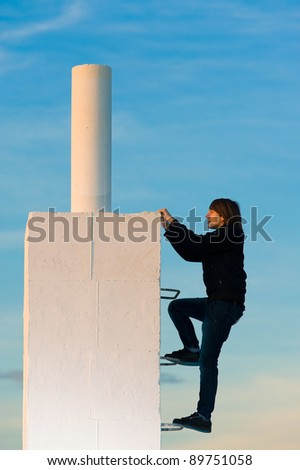 Hardworking teenager working his way up to the top - stock photo