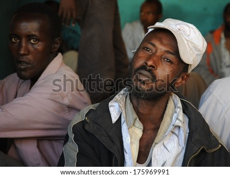HARGEISA, SOMALIA - JANUARY 8, 2010: Khat  - light stimulant drug, is widely distributed in  Somalia . Khat uses up to 90% of the total male population. Men use Khat during a meeting in a cafe.