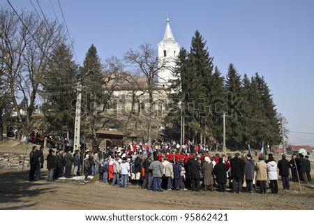 HARGHITA, ROMANIA - MARCH 15: Crowd at commemoration of 163nd anniversary of the Hungarian Revolution on March 15, 2011 in Harghita, Romania - stock photo