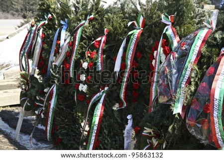 HARGHITA, ROMANIA - MARCH 15: Hungarian wreaths at commemoration of 163nd anniversary of the Hungarian Revolution on March 15, 2011 in Hargita, Romania - stock photo
