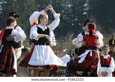 HARGHITA, ROMANIA - MARCH 15: Unidentified  Hungarian folk dancers at commemoration of 163nd anniversary of the Hungarian Revolution on March 15, 2011 in Harghita, Romania - stock photo
