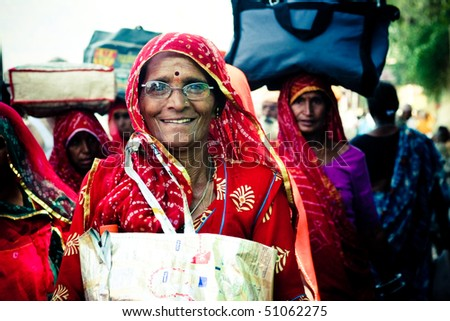 HARIDWAR - APRIL 14: Simple indian woman came to Haridwar to make an ablution in holy Ganga river during Kumbha-mela festival. She is smiling and very happy. April 14, 2010 in Haridwar, India. - stock photo