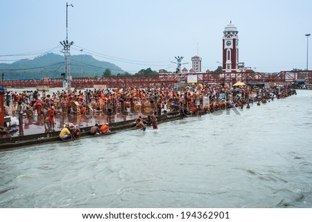 HARIDWAR, INDIA - AUGUST 10 - Hindu Pilgrims gather on the banks of the holy river in preparation for Ganga Artik on August 10th 2010 at Haridwar, India. - stock photo
