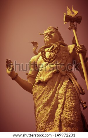 HARIDWAR, INDIA - AUGUST 28: Low angle view of huge statue of Lord Shiva located on Ganges River in Swami Vivekanand park (Delhi Road) on August 28, 2012 in Haridwar