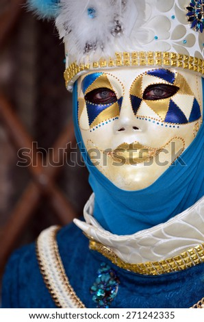 Harlequin style costume at the Venice Carnival - stock photo