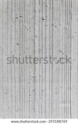 harmonic pattern of a grey concrete wall - stock photo