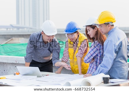 harmonious engineer and technician team discussing in building construction site teamwork collaboration relation concept