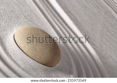 harmony and balance in Japanese zen garden, round stone and lines in sand - stock photo