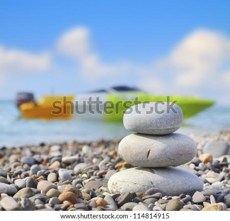 Harmony rocks sea boat sea blue sky - stock photo