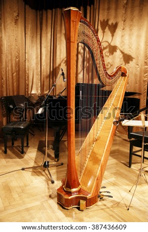 Harp and piano on stage before the concert - stock photo