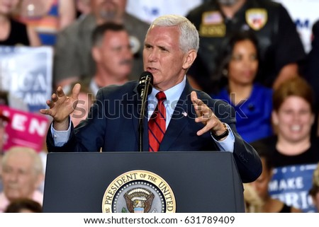 HARRISBURG, PA - APRIL 29, 2017: Vice President Mike Pence gestures as he speaks to supporters at a Trump campaign rally marking 100 days in office at the Farm Show Complex and Expo Center.
