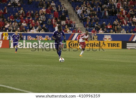Harrison, NJ USA - April 24, 2016: Kevin Molino (18) of Orlando City SC attacks on Red Bulls arena during game against Red Bulls, Red Bulls won with score 3-2 - stock photo