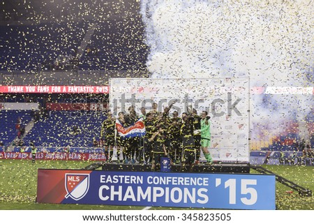 Harrison, NJ USA - November 29, 2015: Team Columbus  Crew SC celebrate winning Eastern Conference cup in MLS playoff series against New York Red Bulls - stock photo