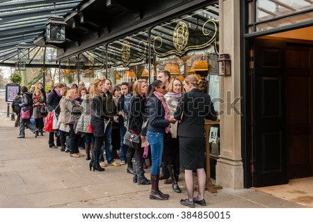 HARROGATE, UK - NOVEMBER 17, 2012: People waiting to enter the famous Bettys Tearoom in Harrogate, North Yorkshire, UK - stock photo